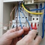 Electrician installing a new fuse box
